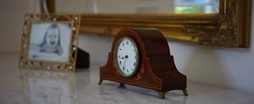 image of a clock on a mantelpiece
